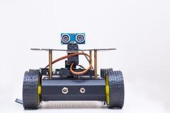 Robot con gli occhi e le ruote Fotografie Stock