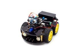 Robot con gli occhi e le ruote su un fondo bianco Int artificiale Fotografia Stock