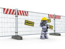 Robot with construction barrier fence Royalty Free Stock Images