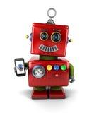 Robot del vintage con smartphone Imágenes de archivo libres de regalías