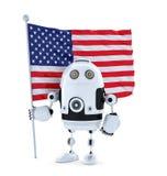 Robot di androide con la bandiera americana diritta Fotografia Stock