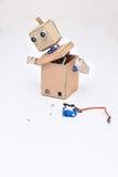 Robot di montaggio del cartone ed i dettagli necessari Immagini Stock Libere da Diritti