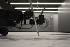 Robot draws graphics at the exhibition Stock Image