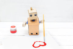 The robot draws with a paintbrush and a red paint. Horizontal stock photos