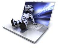 Robot e computer portatile Fotografia Stock