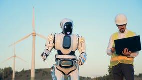 Robot et un homme sur un champ, fin  banque de vidéos