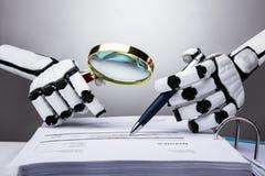 Robot Examining Invoice