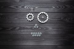 Robot face from gears and nuts on wooden background. Robot face from gears and nuts on dark wooden background stock photography