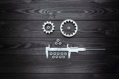 Robot face from gears tool and nuts on wooden background. Robot face from gears tool and nuts on dark wooden background royalty free stock image