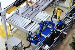 Robot  factory. Intelligent  robot  arm used in modern factory Stock Photo