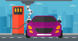 Robot filling up fuel into car at the gas station. Robotic arm filling up fuel into the car at the gas station. Robotic arm refueling a car at the gas station Stock Photo