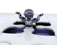 Robot with the final piece of the puzzle Stock Photography