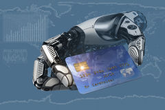 A robot fingers holding plastic credit card Royalty Free Stock Images