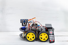 Robot on four wheels and a variety of cables with remote control Royalty Free Stock Photo