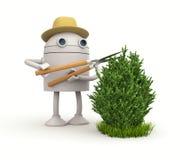 Robot gardener. Robot cuts bush Stock Image
