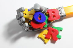 Robot Hand and Alphabets Stock Photos