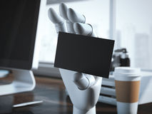 Robot hand with blank business card. 3d rendering. Robot hand with blank business card on the office table. 3d rendering Royalty Free Stock Photo