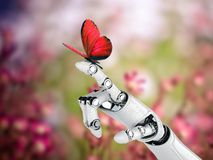 Robot hand and butterfly in nature Royalty Free Stock Images