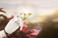 Robot hand with a butterfly on it`s finger royalty free stock photography