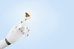 Robot hand with a butterfly on it`s finger royalty free stock image