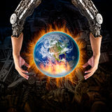 Robot hand embrace the catching fire globe Royalty Free Stock Images