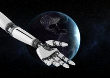 Robot hand  in front of globe against black background Stock Image