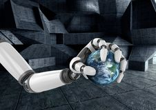 Robot hand holding globe Stock Image