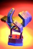 Robot hand holding padlock Royalty Free Stock Image