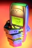 Robot hand holding phone Royalty Free Stock Photo