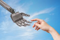 Robot hand and human hand are touching. Artificial intelligence and cooperation concept royalty free stock photos