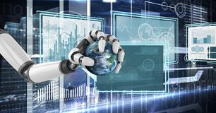 Robot hand interacting with technology interface panels holding planet. Digital composite of Robot hand interacting with technology interface panels holding Stock Photos