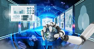 Robot hand interacting with technology interface panels holding world globe. Digital composite of Robot hand interacting with technology interface panels holding Stock Photography