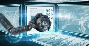 Robot hand interacting with technology interface panels holding world globe. Digital composite of Robot hand interacting with technology interface panels holding Royalty Free Stock Photo