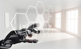 Robot hand push the hexagon button in hexagons. 3d rendering Royalty Free Stock Photography