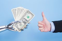 Robot hand take us dollar. And thumb up on the blue background Stock Images