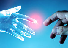 Robot hand touch human hand Stock Photo