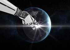 Robot hand touching globe against black background Stock Photos