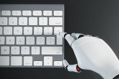 Robot hand typing on a computer keyboard Stock Images