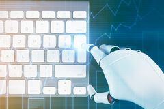 Robot hand typing on a computer keyboard, graphs Royalty Free Stock Photos
