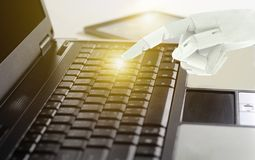 Robot hand use laptop computer, Artificial Intelligence Technology Concept.  stock photos