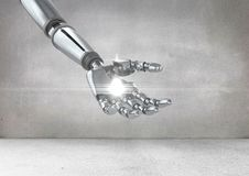 Robot hand with white light. Digital composition of robot hand with white light against grey background Royalty Free Stock Photo