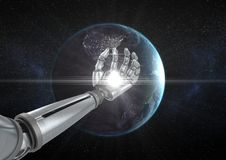 Robot hand with white light in front of globe Stock Images