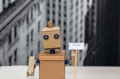 Robot with hands holding a plate Stock Images