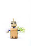 A robot in the hands holds a green plant. Vertical photo Stock Photo