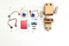 Robot with hands and robotics parts and elements. Flat lay royalty free stock photography