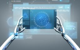 Robot hands with tablet pc over gray background Royalty Free Stock Images