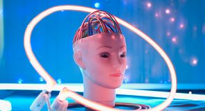 Robot head tests, cyber artificial intelligence brain cables. Science fiction robot head and abstract lights background, futuristic ai technology concepts stock photography