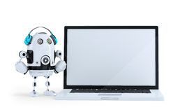 Robot with headphone and huge laptop. . Contains clipping path. Robot with headphone and huge laptop.  on white. Contains clipping path Royalty Free Stock Photos