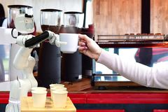 Robot hold hot coffee drinks to people work instead of man future royalty free stock photos