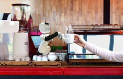 Robot hold hot coffee drinks to people work instead of man future stock photo